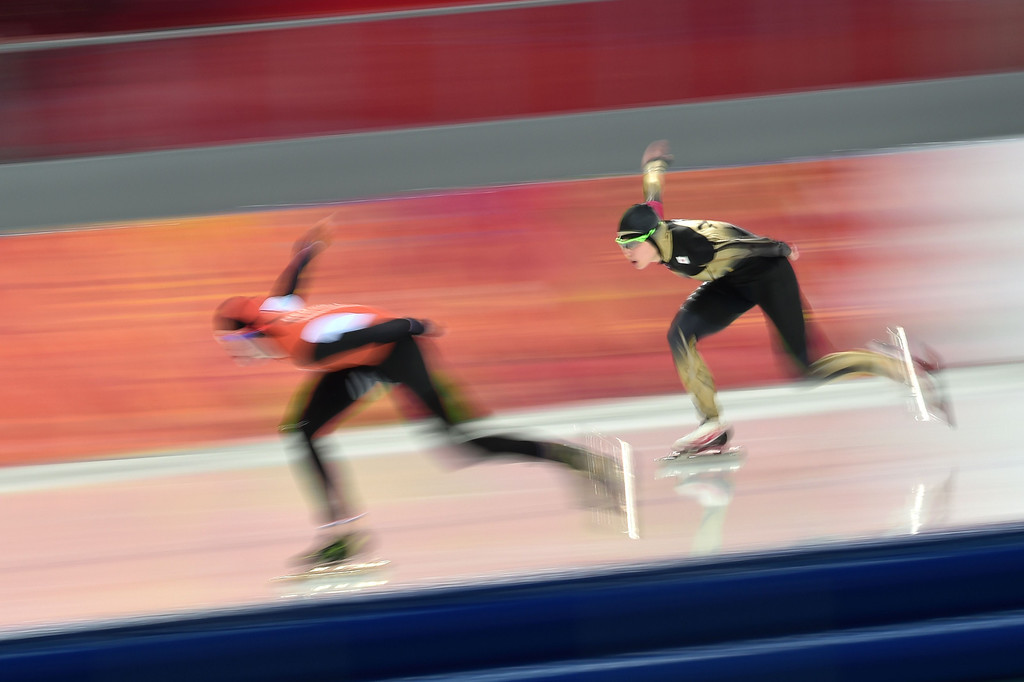 . Netherlands\' Jorien ter Mors (L) and Japan\'s Ayaka Kikuchi compete in the Women\'s Speed Skating 1500 m at the Adler Arena during the Sochi Winter Olympics on February 16, 2014.       DAMIEN MEYER/AFP/Getty Images