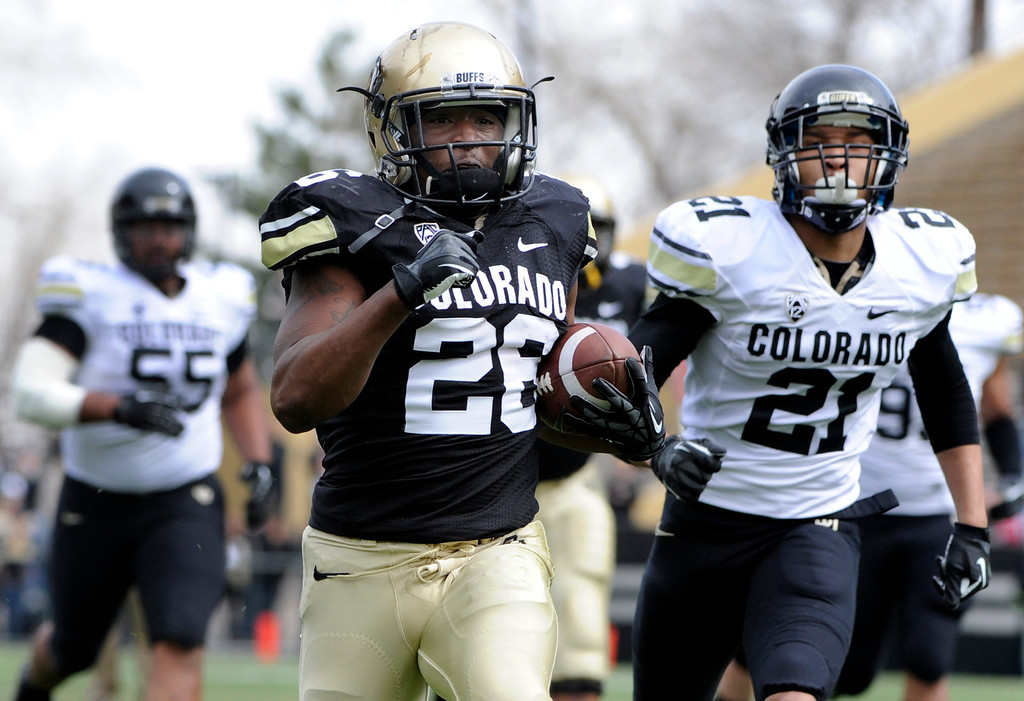 . BOULDER, CO.- APRIL13: Tony Jones outruns his the defenders in to the end zone for six points. The University of Colorado football team hosts its spring football game at Folsom Field under the direction of new head coach Mike MacIntyre. (Photo By Kathryn Scott Osler/The Denver Post)