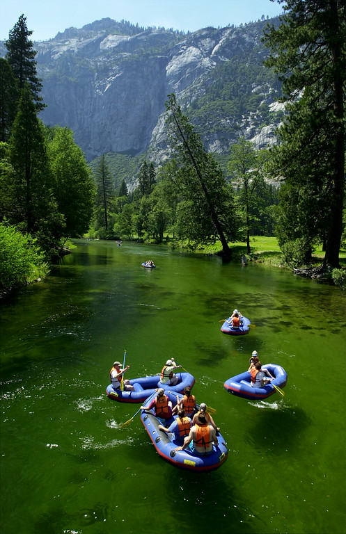 . Visitors to Yosemite National Park in California paddle down the Merced River June 19, 2000.  (Photo by David McNew /Newsmakers)