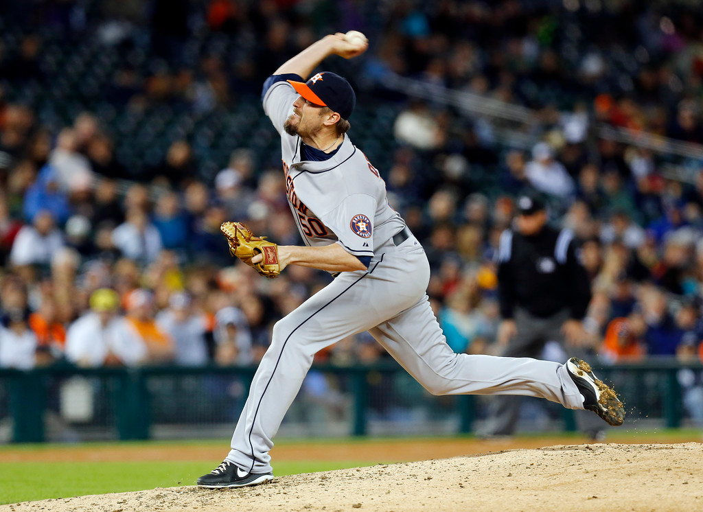 . Houston Astros relief pitcher Chad Qualls throws against the Detroit Tigers in the eighth inning of a baseball game in Detroit, Wednesday, May 7, 2014. (AP Photo/Paul Sancya)