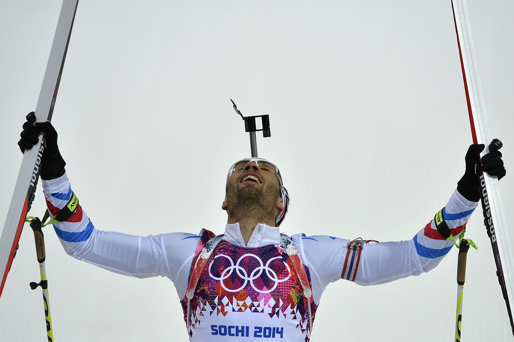 . France\'s Martin Fourcade celebrates as he wins gold in the Men\'s Biathlon 12,5 km Pursuit at the Laura Cross-Country Ski and Biathlon Center during the Sochi Winter Olympics on February 10, 2014 in Rosa Khutor near Sochi.   ODD ANDERSEN/AFP/Getty Images