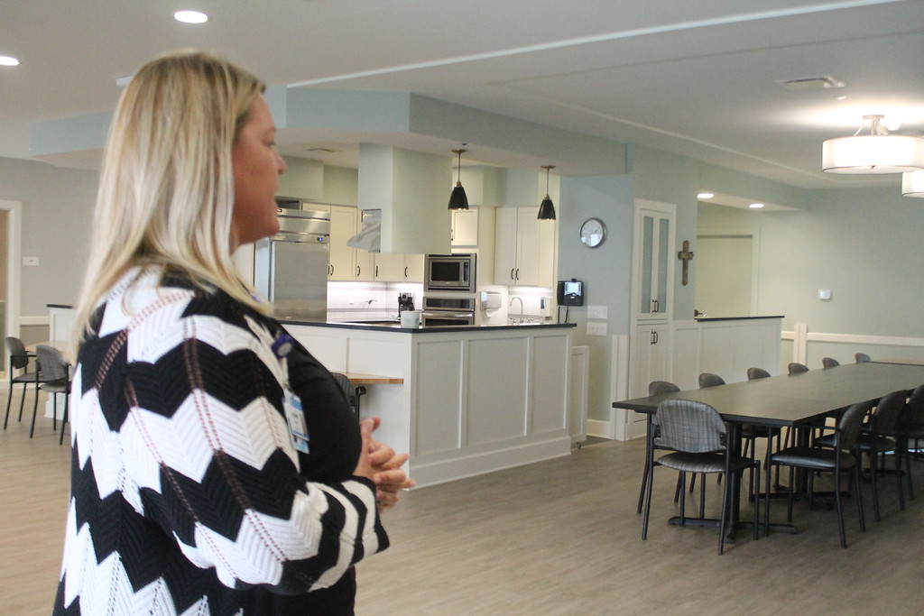 . Jennings president and CEO, Allison Salopeck, shows the shared kitchen and dining area in one of Notre Dame Villages small houses for memory care assisted living  during the Aug. 20 media tour of the newly constructed village. Kristi Garabrandt- The News-Herald