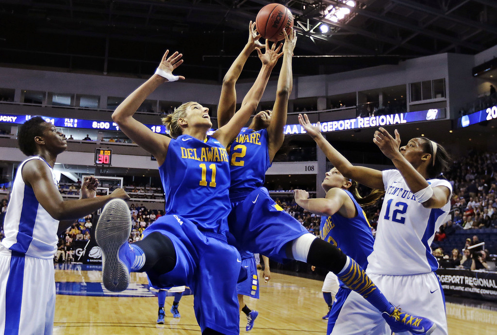 . Delaware forwards Elena Delle Donne (11) and Danielle Parker, third from right, grab a rebound against Kentucky forwards Jelleah Sidney, right, and Samarie Walker, left, during the first half of a regional semifinal in the women\'s NCAA college basketball tournament in Bridgeport, Conn., Saturday, March 30, 2013. (AP Photo/Charles Krupa)