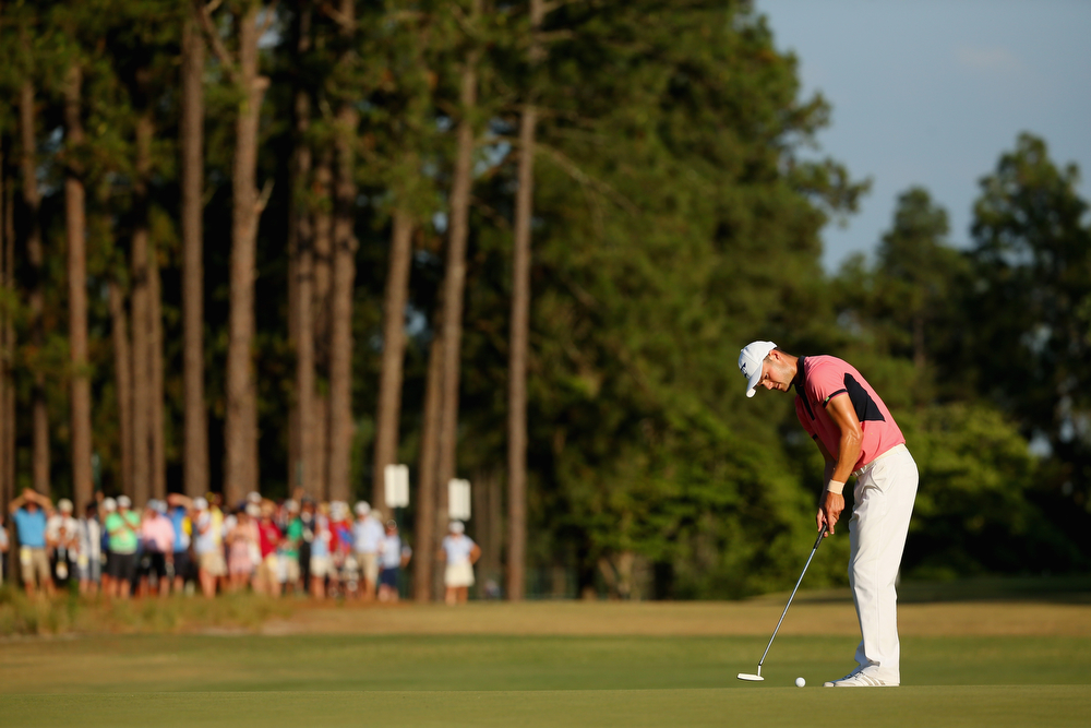 . Martin Kaymer of Germany putts on the 14th hole during the third round of the 114th U.S. Open at Pinehurst Resort & Country Club, Course No. 2 on June 14, 2014 in Pinehurst, North Carolina.  (Photo by Mike Ehrmann/Getty Images)