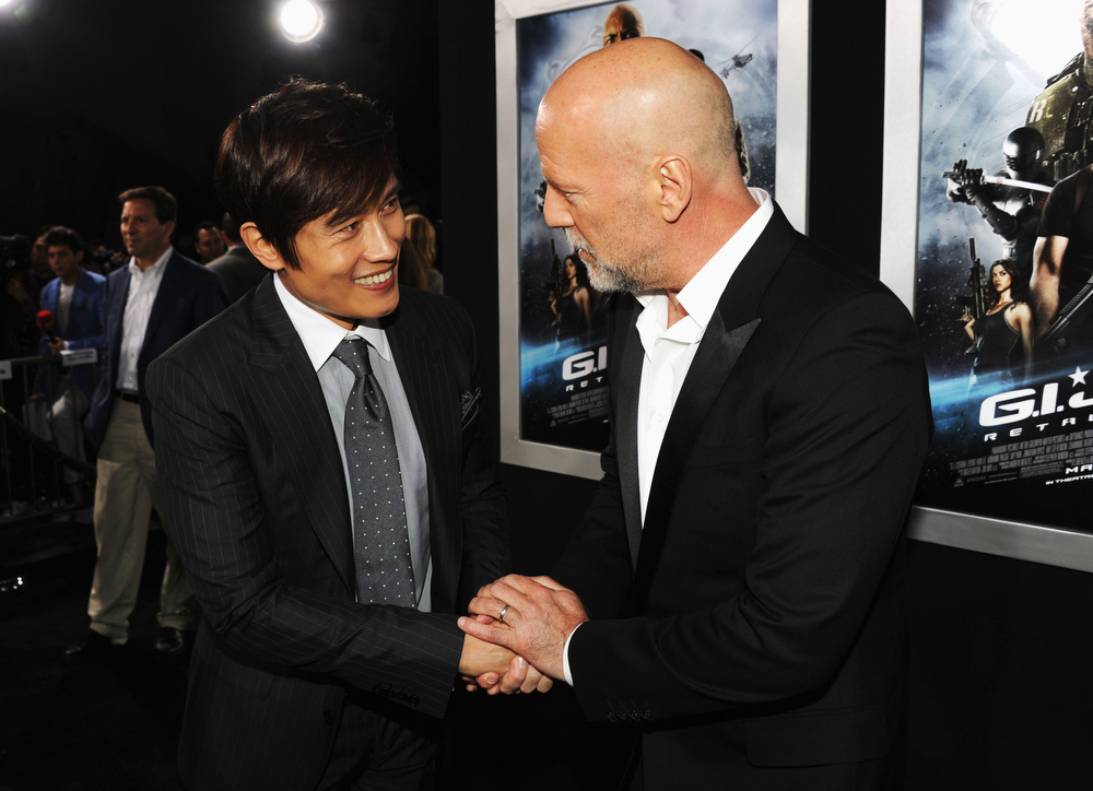 ". Actors Byung-Hun Lee and Bruce Willis attend the premiere of Paramount Pictures\' ""G.I. Joe:Retaliation\"" at TCL Chinese Theatre on March 28, 2013 in Hollywood, California.  (Photo by Kevin Winter/Getty Images)"