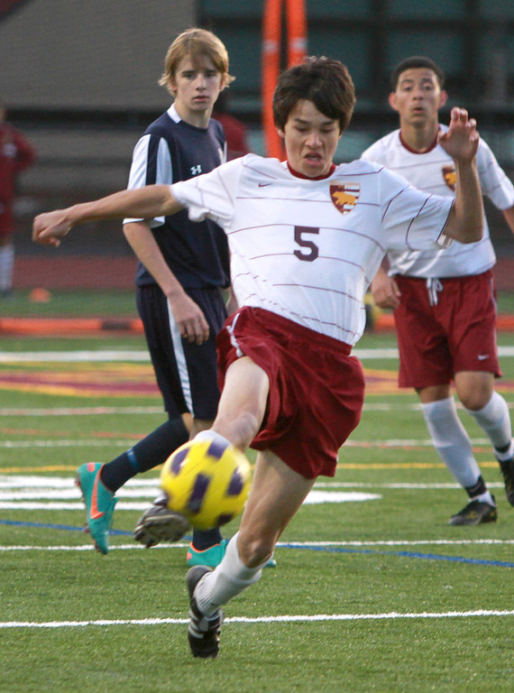 . Menlo-Atherton\'s Alec Witham kicks the ball down field during a game against Carlmont in the second half during a game at Menlo-Atherton High School in Atherton on Monday, Jan. 28, 2013.  (Kirstina Sangsahachart/ Daily News)