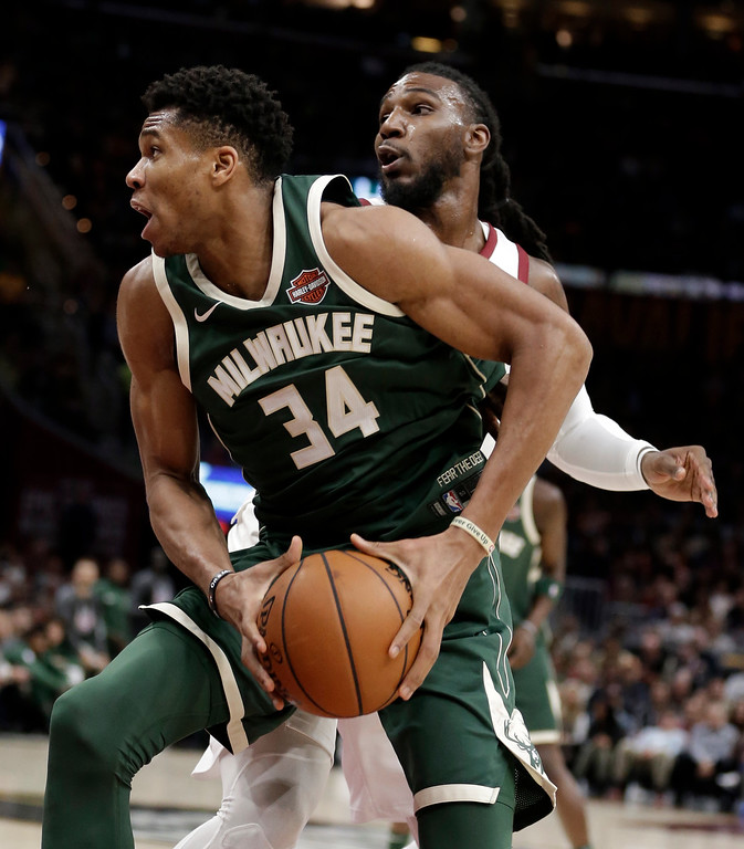 . Milwaukee Bucks\' Giannis Antetokounmpo (34), from Greece, drives against Cleveland Cavaliers\' Jae Crowder (99) in the second half of an NBA basketball game, Tuesday, Nov. 7, 2017, in Cleveland. (AP Photo/Tony Dejak)