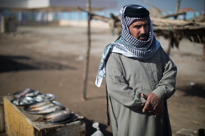 At a small roadside stall beside the marshes. The inhabitants of the Tigris-Euphrates marshlands are the Marsh Arabs.