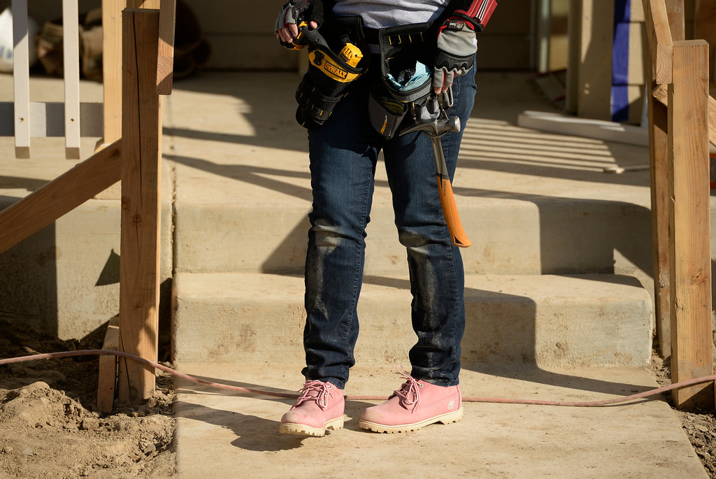 . DENVER, CO - OCTOBER 09: Trisha Yearwood wears pink work boots as she works during Habitat for Humanity\'s Carter Work Project event in the Globeville Neighborhood in Denver, October 09, 2013. The Humanity\'s Carter Work Project will complete 11 new townhouses. (Photo By RJ Sangosti/The Denver Post)