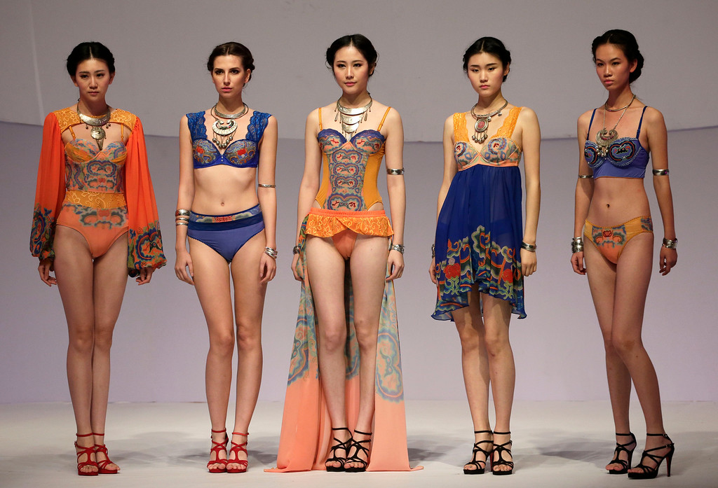 . Models present creations during the Ordifen Cup China Lingerie Design Contest at China Fashion Week in Beijing, China Wednesday, Oct. 29, 2014. (AP Photo/Andy Wong)