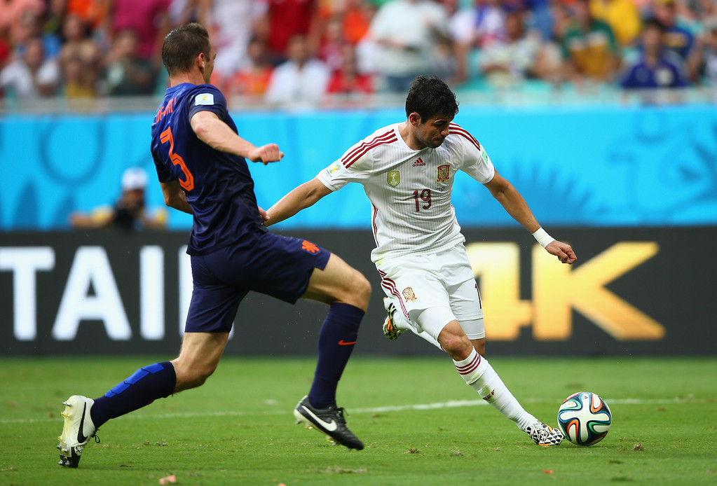 . Stefan de Vrij of the Netherlands moves in to challenge Diego Costa of Spain in the first half during the 2014 FIFA World Cup Brazil Group B match between Spain and Netherlands at Arena Fonte Nova on June 13, 2014 in Salvador, Brazil.  (Photo by Paul Gilham/Getty Images)