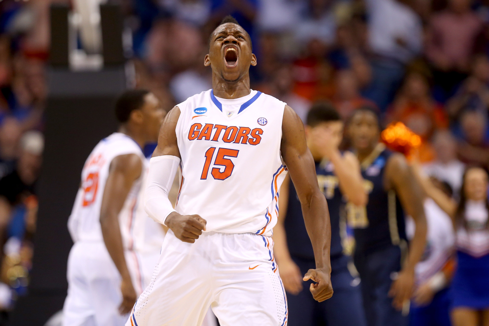 . Will Yeguete #15 of the Florida Gators reacts in the second half while taking on the Pittsburgh Panthers during the third round of the 2014 NCAA Men\'s Basketball Tournament at Amway Center on March 22, 2014 in Orlando, Florida.  (Photo by Mike Ehrmann/Getty Images)