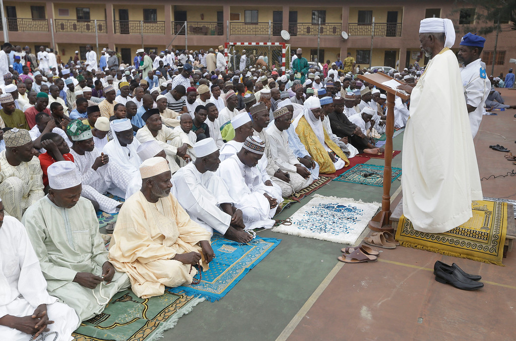 . Nigeria Muslims listen to sermon by Imam Bashir Umar Imam as they gather for prayers to celebrate Eid al-Adha, or Feast of Sacrifice, that commemorates the Prophet Ibrahim\'s faith, at the prayer ground in Lagos, Nigeria, Monday, Sept. 12, 2016. Eid al-Adha marks the end of hajj. (AP Photo/Sunday Alamba)