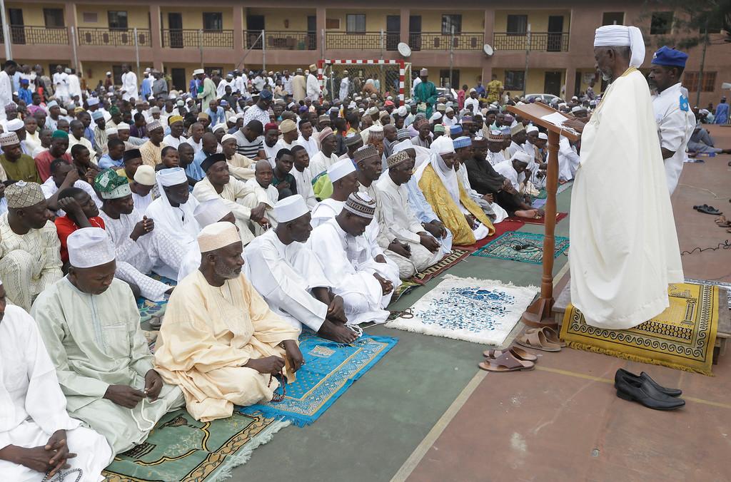. Nigeria Muslims listen to sermon by Imam Bashir Umar Imam as they gather for prayers to celebrate Eid al-Adha, or Feast of Sacrifice, that commemorates the Prophet Ibrahim\'s faith, at the prayer ground in Lagos, Nigeria, Monday, Sept. 12, 2016. Eid al-Adha marks the end of hajj. (AP Photo/Sunday Alamba)