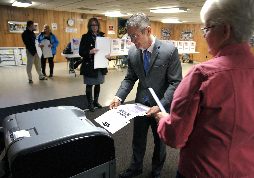 . Mark Schauer, Democratic candidate for governor, casts his ballot early Tuesday, Nov. 4, 2014 at the Bedford Lions Club in Battle Creek, Mich. Schauer is running against incumbent Gov. Rick Snyder. (AP Photo/Battle Creek Enquirer, Seth Graves)