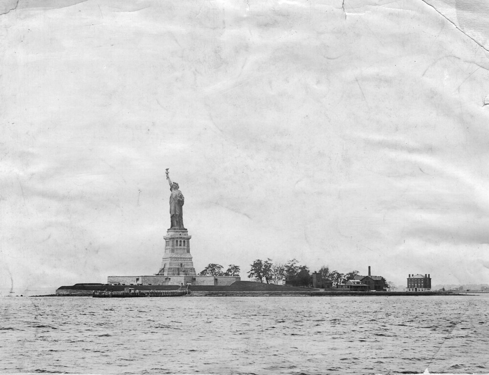. circa 1955:  The Statue of Liberty in New York Harbour is a colossal bronze female figure holding a torch, titled \'Liberty Enlightening The World\'. It was a gift from the French people to the USA to commemorate the centenary of Independence. Erected on a high granite pedestal on Liberty Island in 1885.  (Photo by Hulton Archive/Getty Images)
