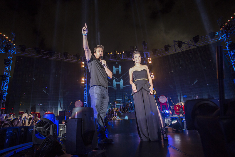 """. Mark Wahlberg and Li Bingbing introduce Imagine Dragons at the Ocean Terminal Rooftop Car Park to celebrate the worldwide premiere screening of \""""Transformers: Age of Extinction\"""" on June 19, 2014 in Hong Kong, Hong Kong.  (Photo by Jerome Favre/Getty Images for Paramount)"""