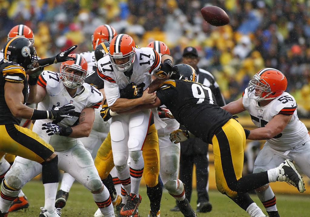 . Jason Campbell #17 of the Cleveland Browns fumbles the ball while being tackled by Cameron Heyward #97 and Brett Keisel #99 of the Pittsburgh Steelers during the game on December 29, 2013 at Heinz Field in Pittsburgh, Pennsylvania.  (Photo by Justin K. Aller/Getty Images)
