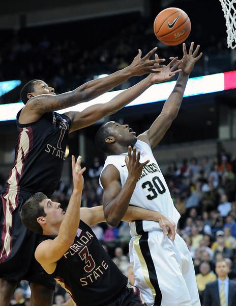 Travis McKie fights for rebound.jpg