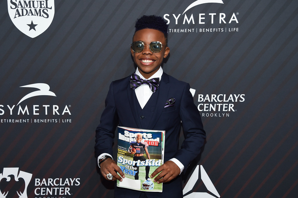 ". S.I. Kids SportsKid of the year honoree Maxwell ""Bunchie\"" Young attends the Sports Illustrated 2017 Sportsperson of the Year Awards at the Barclays Center on Tuesday, Dec. 5, 2017, in New York. (Photo by Evan Agostini/Invision/AP)"