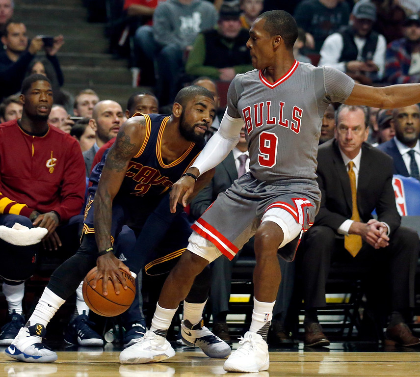 . Cleveland Cavaliers guard Kyrie Irving, left, controls the ball against Chicago Bulls guard Rajon Rondo during the first half of an NBA basketball game Friday, Dec. 2, 2016, in Chicago. (AP Photo/Nam Y. Huh)