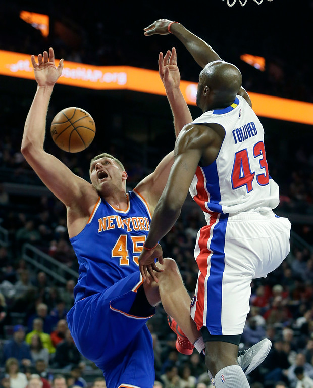 . Detroit Pistons forward Anthony Tolliver (43) blocks a shot by New York Knicks center Cole Aldrich (45) during the first half of an NBA basketball game, Friday, Feb. 27, 2015 in Auburn Hills, Mich. (AP Photo/Carlos Osorio)