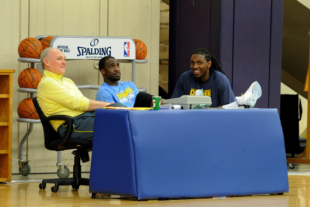 . Head coach George Karl of the Denver Nuggets chats with Ty Lawson and Kenneth Faried at the table during practice April 22, 2013 at Pepsi Center. (Photo By John Leyba/The Denver Post)