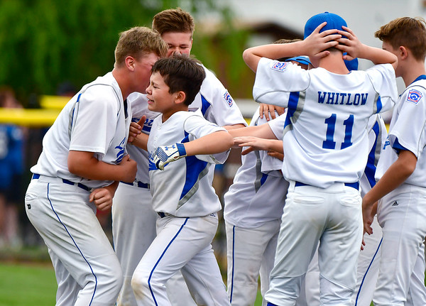 8/6/2019 Mike Orazzi | Staff Maine's celebrates a win over Vermont during the Eastern Regional Little League Baseball Tournament at Breen Field in Bristol on Tuesday.