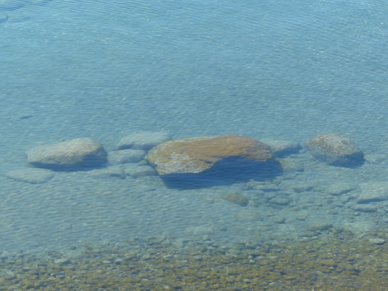 Lake Ontario's clear water and boulders.
