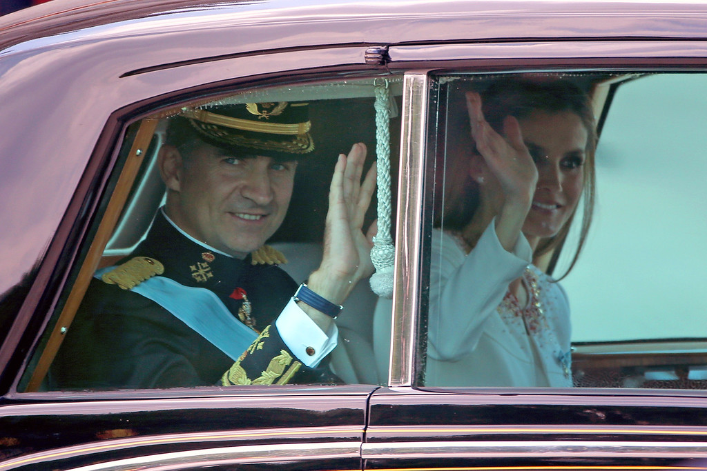 . King Felipe VI of Spain and Queen Letizia of Spain wave to crowds as they leave the Royal Palace after the King\'s official coronation ceremony on June 19, 2014 in Madrid, Spain.   (Photo by Christopher Furlong/Getty Images)