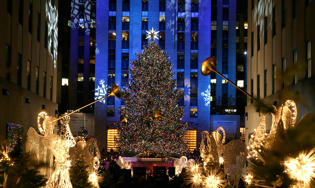 . The Rockefeller Center Christmas tree is lit in New York, Wednesday, Dec. 3, 2008. (AP Photo/Diane Bondareff)