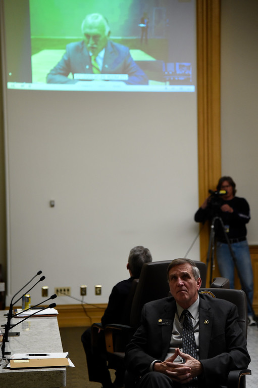 . DENVER, CO. - March 09, 2015: Senator Chris Holbert of Parker (facing away) and and Senator John Cooke of Greeley watch a testimony is shared from other parts of the state as the Senate Judiciary Committee take\'s up Senate Bill 175, by Republican the Senators at the State Capital; the bill repeals ammunition magazine limits imposed by the 2013 legislature. March 09, 2015 Denver, CO (Photo By Joe Amon/The Denver Post)