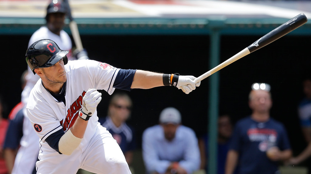 . Cleveland Indians�Yan Gomes hits a two-run single off Detroit Tigers relief pitcher Al Alburquerque in the seventh inning of a baseball game, Wednesday, June 24, 2015, in Cleveland. Carlos Santana and Brandon Moss scored on the play. The Indians won 8-2. (AP Photo/Tony Dejak)