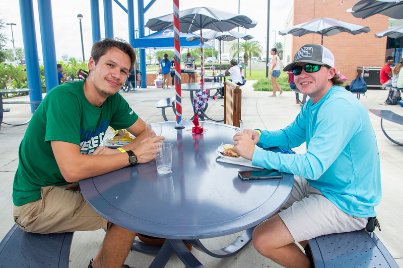 Travis Chudej (left) and Hogan Benedict come by the UC Sea Breeze Patio for the All American Red, White and Blue cookout and live music by local country artist Jade Marie Patek