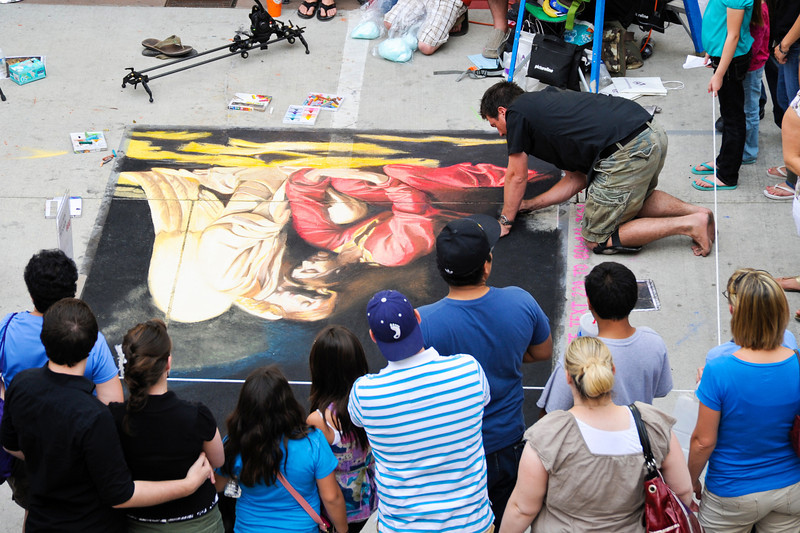 2011/6/18a – After seeing Mamma Mia we went to the Chalk Art Festival at the Gateway. This artist had been working on a copy of a Carl Block painting, recreating it at about full size. At this point he had been working on his knees for 17 hours to create this masterpiece. Check out the time lapse video of the art being created at: http://bit.ly/jnPyfY  The next day the forecast was for rain so it isn't going to last very long.