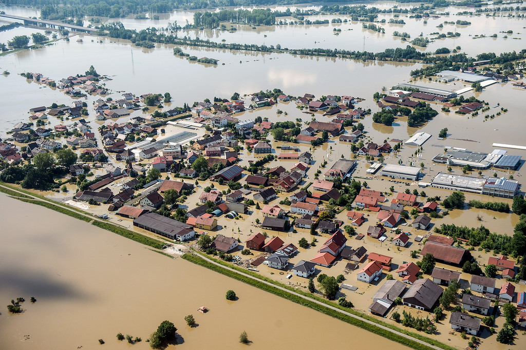 . Aerial view shows flooding in Deggendorf, southern Germany on June 5, 2013. Cities in Germany and the Czech Republic were scrambling to stave off potential disaster as a flood wave headed north, sending thousands of people fleeing their homes. AFP PHOTO / ARMIN WEIGEL /AFP/Getty Images