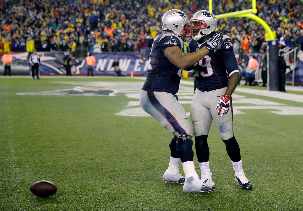 . New England Patriots running back LeGarrette Blount, right, celebrates his touchdown with linebacker Jerod Mayo during the second half of an AFC divisional NFL playoff football game against the Indianapolis Colts in Foxborough, Mass., Saturday, Jan. 11, 2014. (AP Photo/Matt Slocum)
