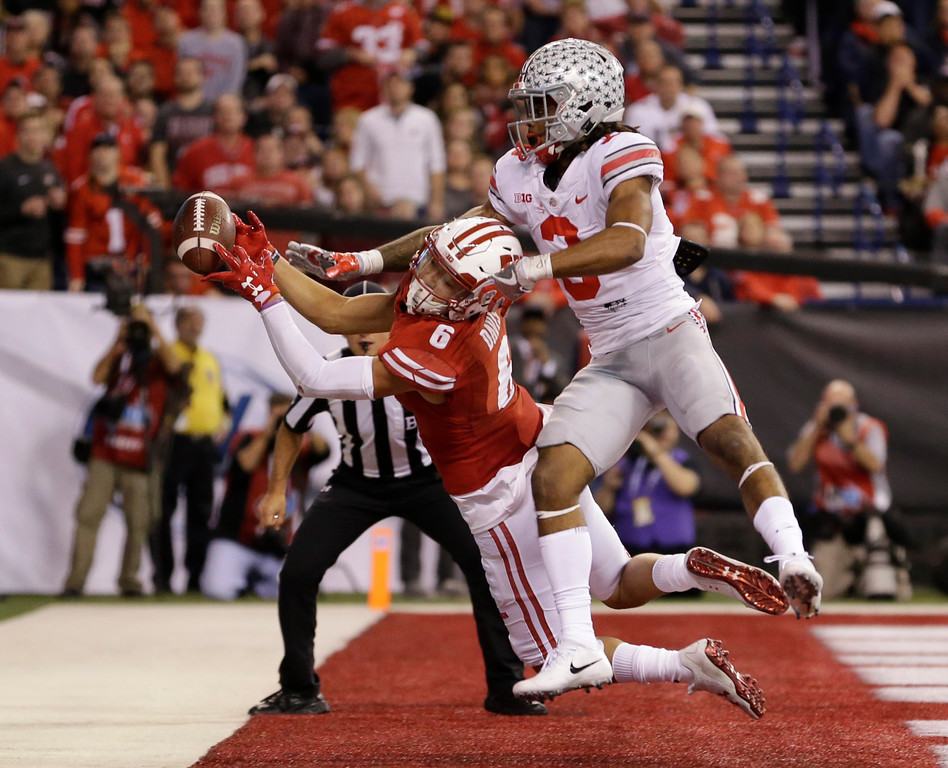 . Wisconsin\'s Danny Davis III (6) tries to make a catch while being defended by Ohio State\'s Damon Arnette during the second half of the Big Ten championship NCAA college football game, Saturday, Dec. 2, 2017, in Indianapolis. The pass was incomplete. (AP Photo/AJ Mast)
