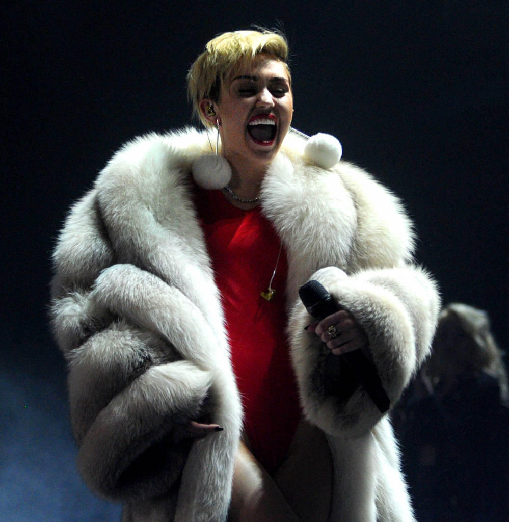 """. Miley Cyrus entertains the crowd with her opening number \""""Party in the USA\""""  at Xcel Energy Center in St. Paul, Tuesday, December 10, 2013. (Pioneer Press: Chris Polydoroff)"""