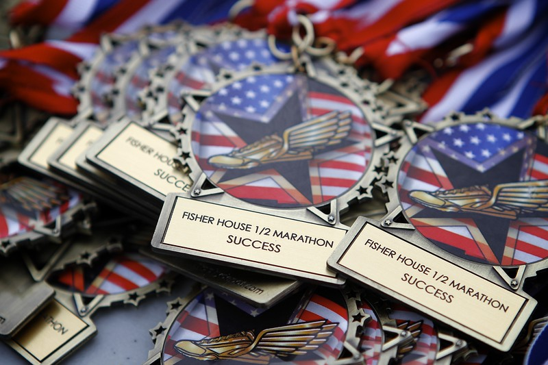 Kevin Bartram | Staff Medals await the finishers at the Bristol half marathon for the Fisher House on Sunday in Bristol.