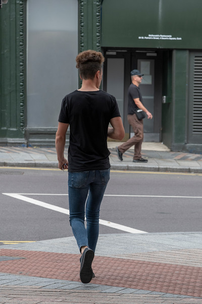 View of pedestrian waiting to cross the road, City of Cork, County Cork, Ireland