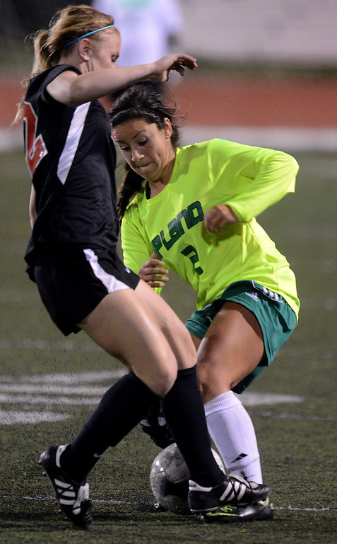 . BS15-UPLANDSOCCER-02-JCM (Jennifer Cappuccio Maher/Staff Photographer) San Clemente\'s Sami Engel, left, guards Upland\'s Isabella Solorzano as she tries to advance the ball during the CIF-SS Division 1 playoff game Thursday, February 14, 2013, at Upland High School in Upland. Upland was eliminated by San Clemente 1-0 in overtime.
