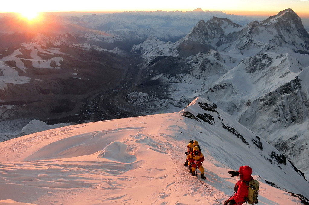 . In this image from sunrise on Saturday, May 18, 2013, climbers make their way to the summit of Mount Everest, in the Khumbu region of the Nepal Himalayas.  Nepal celebrated the 60th anniversary of the conquest of Mount Everest on Wednesday, May 29, 2013, by honoring climbers who followed in the footsteps of Edmund Hillary and Tenzing Norgay.  (AP Photo/Alpenglow Expeditions, Adrian Ballinger)