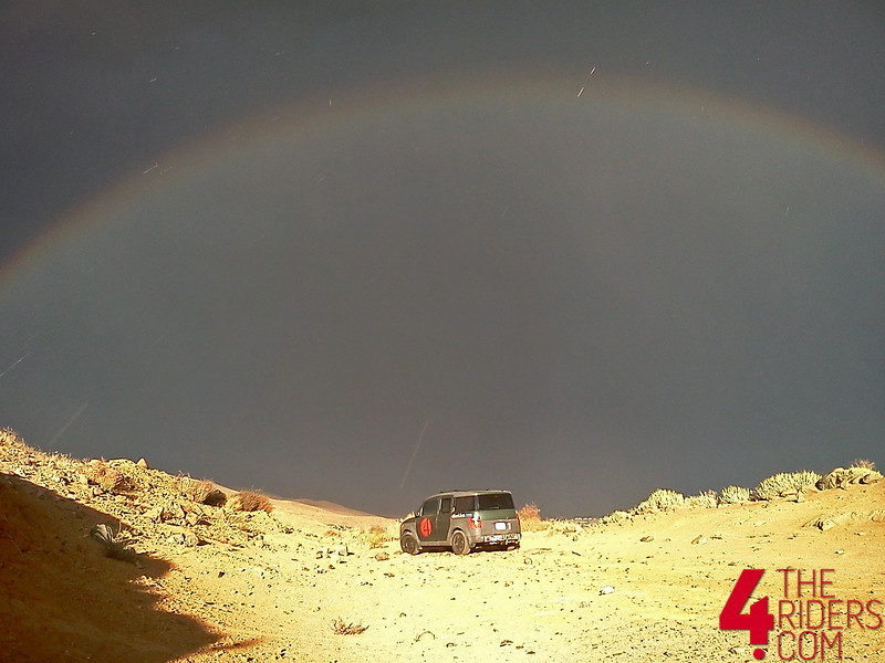 rainbow over honda element in the desert