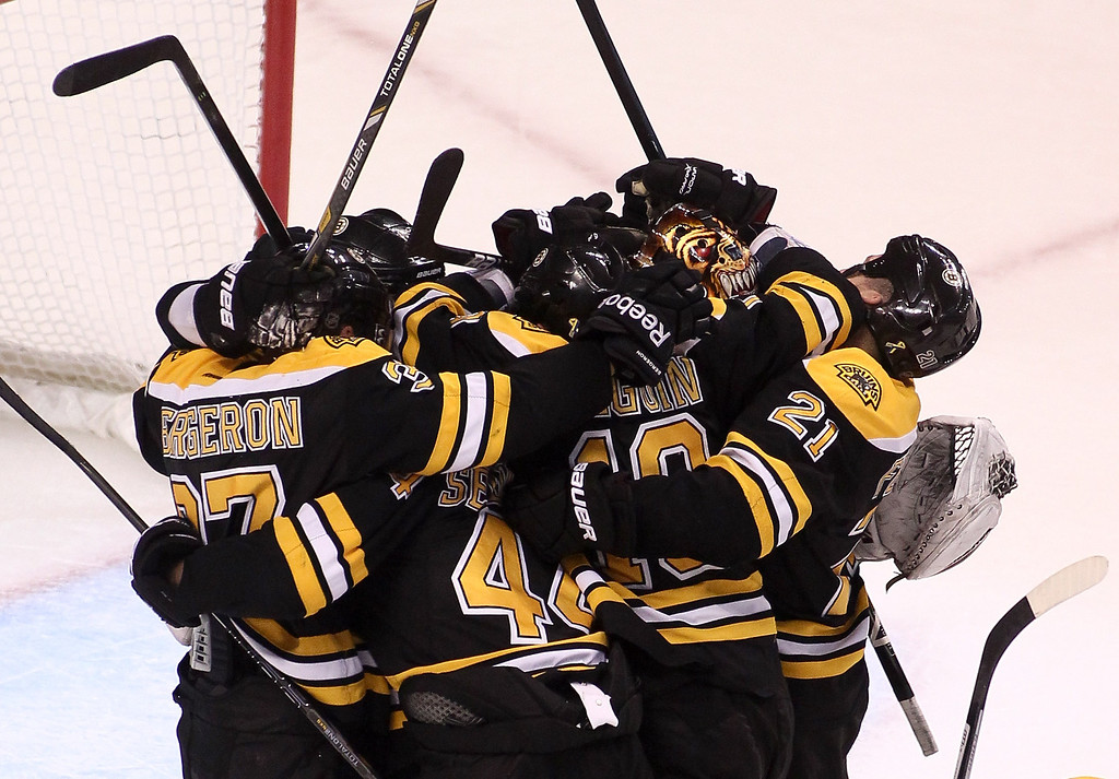 . BOSTON, MA - JUNE 07:  Brad Marchand #63 of the Boston Bruins celebrates with teammates after defeating the Pittsburgh Penguins 1-0 in Game Four of the Eastern Conference Final during the 2013 Stanley Cup Playoffs at TD Garden on June 7, 2013 in Boston, Massachusetts.  (Photo by Alex Trautwig/Getty Images)
