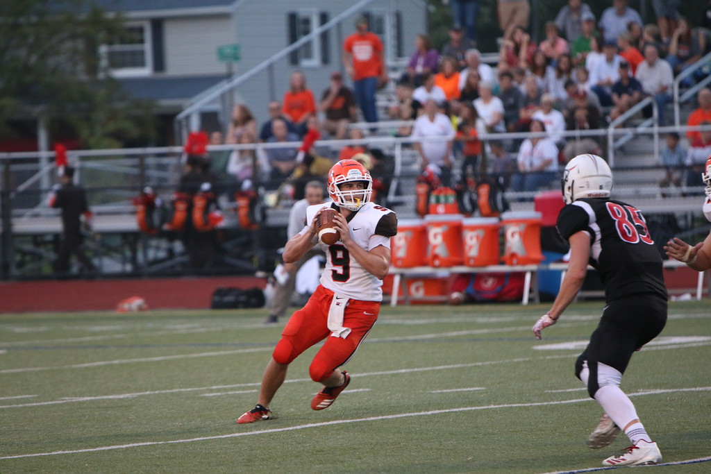 . Kyle Sooy - The Morning Journal<br> Buckeye\'s Jacob Doerge looks for an open receiver against Lutheran West on Sept. 14.