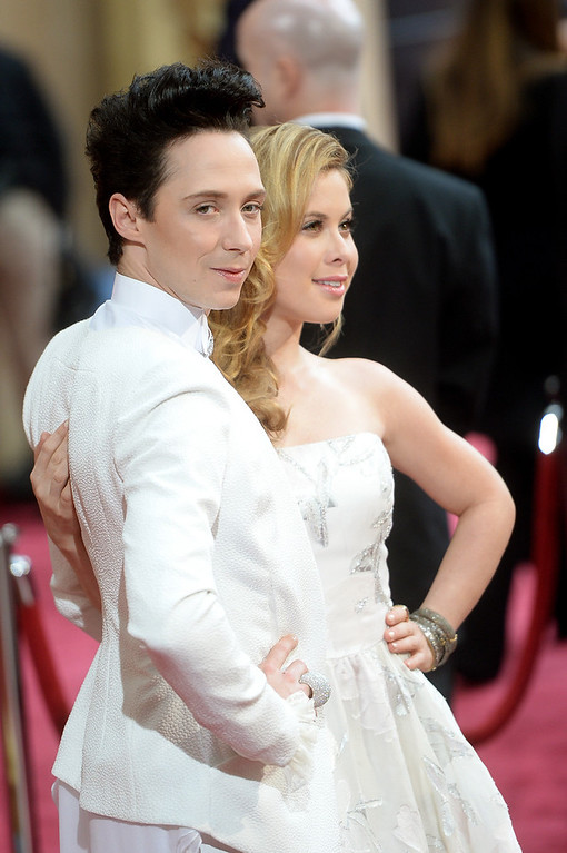 . TV personalities Johnny Weir (L) and Tara Lipinski attend the Oscars held at Hollywood & Highland Center on March 2, 2014 in Hollywood, California.  (Photo by Michael Buckner/Getty Images)