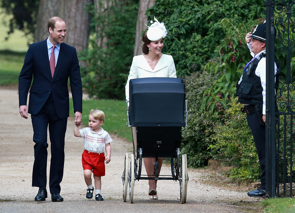 . Catherine, Duchess of Cambridge, Prince William, Duke of Cambridge, Princess Charlotte of Cambridge and Prince George of Cambridge are saluted by a policeman as they arrive at the Church of St Mary Magdalene on the Sandringham Estate for the Christening of Princess Charlotte of Cambridge on July 5, 2015 in King\'s Lynn, England.  (Photo by Chris Jackson/Getty Images)