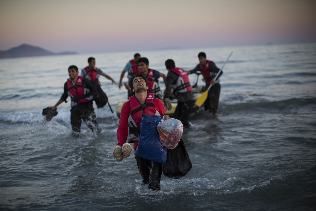 . Migrants from Pakistan land on shore after completing a journey in a small dinghy crossing a three mile stretch of the Aegean Sea from Turkey August 31, 2015 in Kos, Greece. Migrants from many parts of the Middle East and African nations continue to flood into Europe before heading from Athens, north to the Macedonian border. Since the beginning of 2015 the number of migrants using the so-called \'Balkans route\' has exploded with migrants arriving in Greece from Turkey and then traveling on through Macedonia and Serbia before entering the EU via Hungary. The number of people leaving their homes in war torn countries such as Syria, marks the largest migration of people since World War II. (Photo by Dan Kitwood/Getty Images)