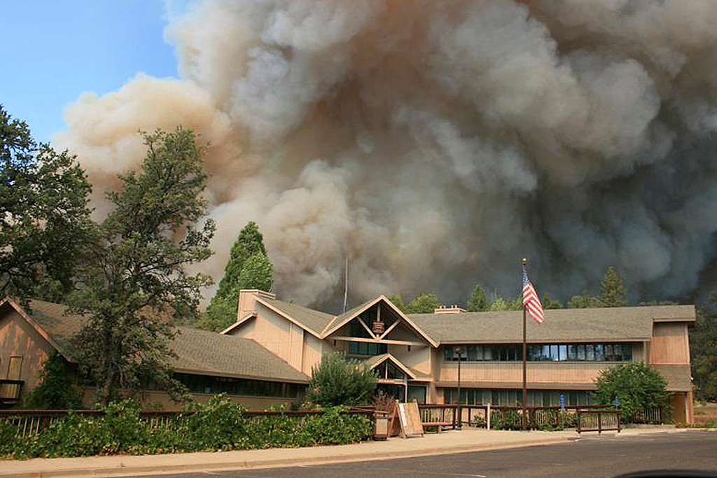 . In this undated photo provided by the U.S. Forest Service, the Rim Fire burns near Groveland Ranger Station in Groveland, Calif. The wildfire outside Yosemite National Park, one of more than 50 major brush blazes burning across the western U.S., more than tripled in size overnight and still threatens about 2,500 homes, hotels and camp buildings. Fire officials said the blaze burning in remote, steep terrain had grown to more than 84 square miles and was only 2 percent contained on Thursday, down from 5 percent a day earlier. (AP Photo/U.S. Forest Service)